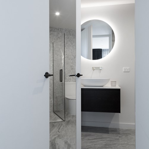 Metro Performance Glass 900mm diameter round bathroom mirror and a full length door mirror.jpg